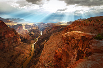 Foto op Canvas Rood paars Smoky rays above the Grand Canyon, Arizona, USA.