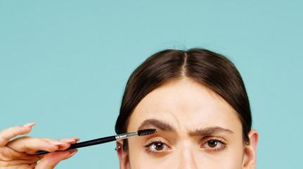 Eyebrows correction. Shape. Perfect natural eyebrows and eyelashes. Lush eyebrow. Natural make up. Beauty. Eyebrows and eyelashes close up.