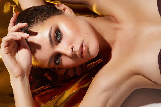 Beautiful sexy woman make-up golden tan beauty skin