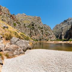 Beautiful summer landscape of nature in Mallorca island. River Torrent de Pareis between rocky...