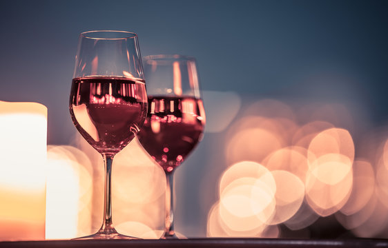 Candlelight dinner with wine and romantic city view