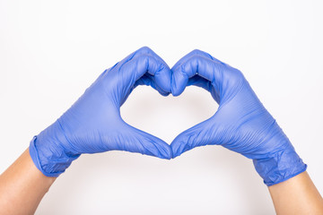 Heart made of latex, nitrile medical gloves for doctor and nurse protection on white background