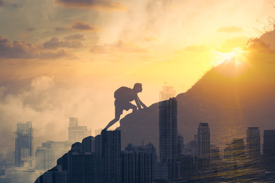 People achieving goals, determination and taking risk concept Man climbing up a mountain.