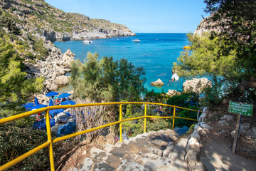 Concrete stairs with rails to small beach in Anthony Quinn bay (Rhodes, Greece)