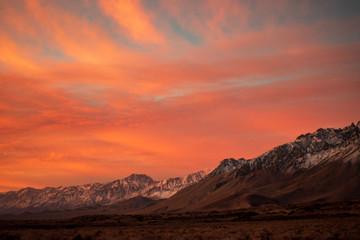 first morning sunlight illuminates snowy mountain peaks in California