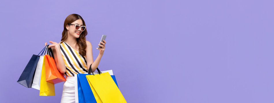 Beautiful Asian woman shopping online with mobile phone on banner background