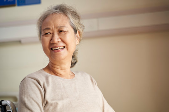 portrait of an asian senior woman looking away smiling