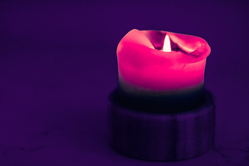 Pink holiday candle on purple background, luxury branding design and decoration for Christmas, New...