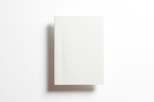 Blank glossy portrait paper square catalog magazine in the air isolated on white with soft shadows