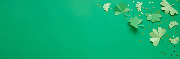 St. Patrick's day, clover on a green shiny background