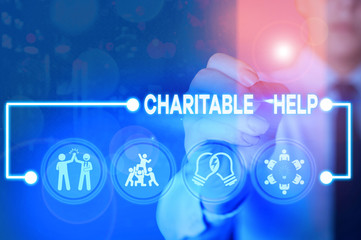 Writing note showing Charitable Help. Business concept for system of giving money or help free to those who are in need