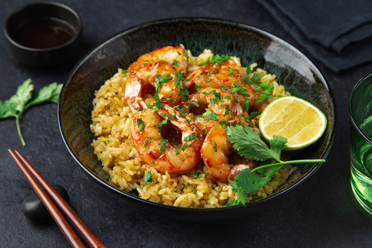 fried rice and prawn in  bowl