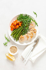 Grilled chicken breast, fillet with butternut squash or pumpkin, green beans and fresh arugula salad, healthy food, top view