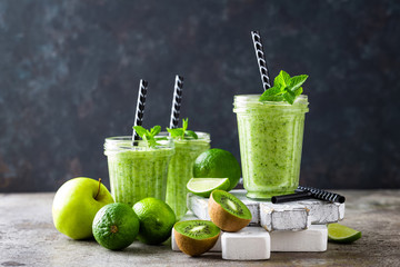 Vegan antioxidant green smoothie, organic cocktail with fresh kiwi fruit, apple, lime and mint, healthy food, vegetarian detox diet