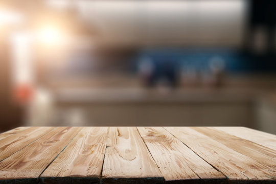 Wooden surface on blurred background of room in apartment.