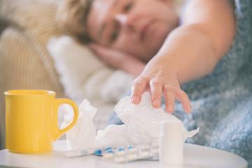 Mature woman suffering from coronavirus, flu or cold