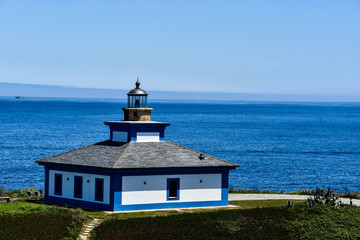 lighthouse on coast of sea, photo as a background , in north spain, galicia, spain, europe