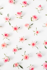 Floral composition with pink rose flower buds and leaves pattern texture on white background....