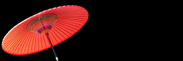 Red japanese umbrella on panoramic black background with copy space Wall mural