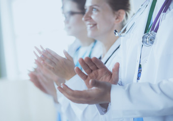 Medical team clapping their hands during a meeting
