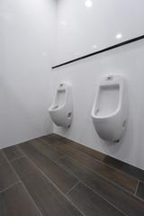 Modern toilet row of white ceramic urinal chamber pot interior design in modern building