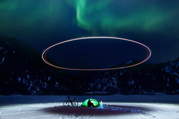 Keuken foto achterwand UFO Man with bicycle at frozen lake at night