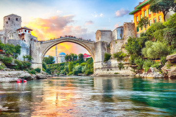Photo sur Aluminium Con. Antique Fantastic Skyline of Mostar with the Mostar Bridge, houses and minarets, at sunset