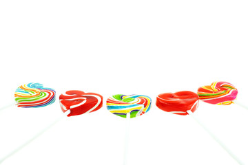 Rainbow heart-shaped Lollipop candy on white background, Valentine's Day concept