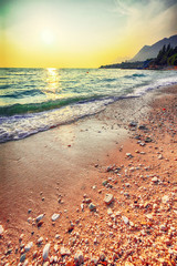 Sunset overview across the beautiful beach of Gradac in Makarska riviera.