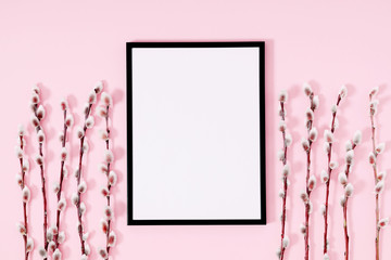 Beautiful flowers composition. Spring background. Photo frame, branches willows on pastel pink background. Valentines Day, Easter, Happy Women's Day, Mother's day. Flat lay, top view