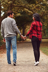 Couple in love walking through the park. Love concept.