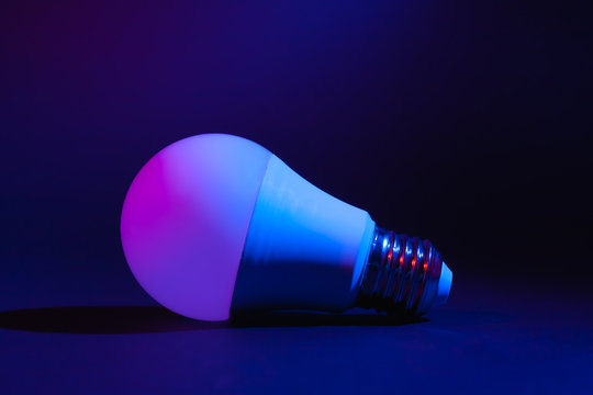 Smart LED lamp, economical and durable with the ability to adjust color and brightness. Stock photo of a tech ice lamp.