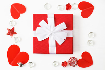 gift box with red hearts on a white background. greeting card
