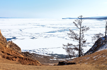 Beautiful spring landscape with ice drift on Lake Baikal. View from Olkhon Island to the Sarayskiy Bay and the island of Kharantsy on an April morning. Change of seasons. Natural background