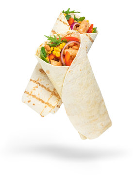 Tortilla wrap with fried chicken meat and vegetables isolated on white background
