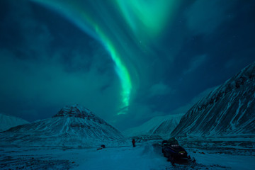 The polar arctic Northern lights aurora borealis sky star in Norway Svalbard in Longyearbyen  with the  mountains. Travel adventure