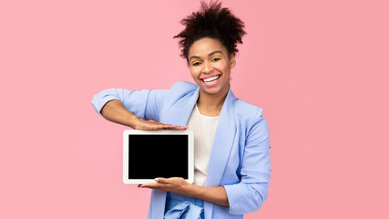 Wall Mural - Happy black woman showing black blank computer screen