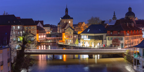 Fototapete - Aerial panoramic view of Old town hall or Altes Rathaus with bridges over the Regnitz river at night in Bamberg, Bavaria, Upper Franconia, Germany