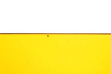 Fototapeten Retro Cooking oil flow isolated on white. Color liquid