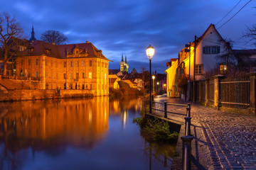 Fototapete - Scenic view of Old town over the Regnitz river at night in Bamberg, Bavaria, Upper Franconia, Germany