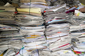 close up view of stacks of paper and magazines and newspapers ready to be recycled