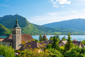 charming view on Annecy lake with old church in France