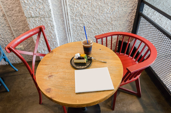 Red chairs and wooden table in coffee shop