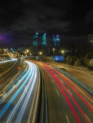 Fotobehang Nacht snelweg Night with traffic long exposure 4 towers of Madrid