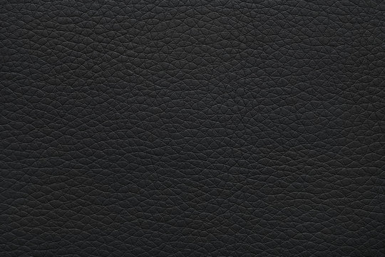 Texture of black leather as background, closeup