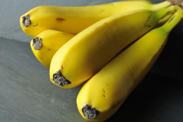organic bananas on a gray slate background