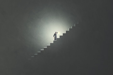 man with lamp rising stairs in the darkness Wall mural