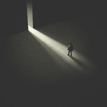 man walking in the night following light