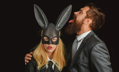 Bunny mask woman. Serious man with beard. Rabbit and girl. Lovely woman in rabbit costume. Stylish man. Young girl easter woman in bunny ears.