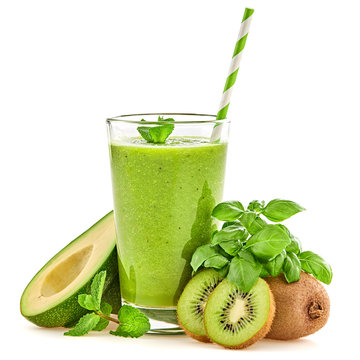 Healthy fresh fruit green smoothie in glass. Raw assorted ingredients isolated on white. Set green organic fruits and vegetables for smoothie. Creative weight loss smoothies dieting concept
